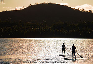 paddle boarding infront of aitutaki village